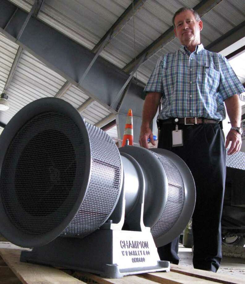 Fire Marshal/ Emergency Management Coordinator Mark Mattick stands by Boerne's antique siren, which was first installed around 1940. It was silenced in November but will sound again soon. Zeke MacCormack / zeke@express-news.net Photo: Zeke MacCormack/zeke@express-news.net