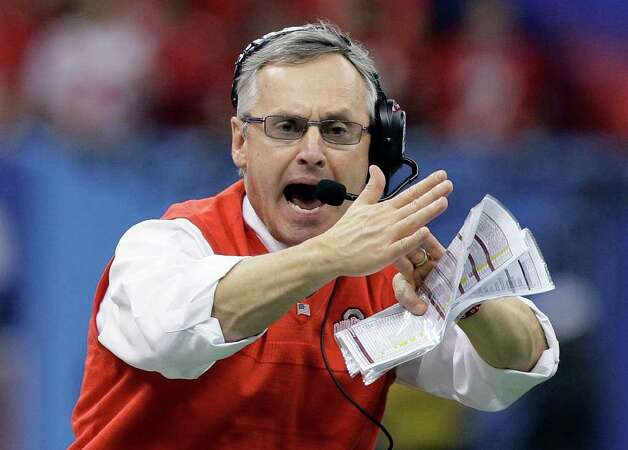 FILE - in a  Jan. 4, 2011 file photo, Ohio State coach Jim Tressel signals for a timeout during the Sugar Bowl NCAA college football game against Arkansas at the Louisiana Superdome in New Orleans. Ohio State announced Monday, May 30, 2011 that football coach Jim Tressel has resigned as the NCAA investigates the Buckeyes for possible rules violations. Tressel says in a statement that he met with university officials and agreed that it is in Ohio State's best interest that he resign. The school says Luke Fickell, an assistant head coach under Tressel, will serve as interim head coach for the 2011-2012 season. (AP Photo/Patrick Semansky, File) Photo: Patrick Semansky