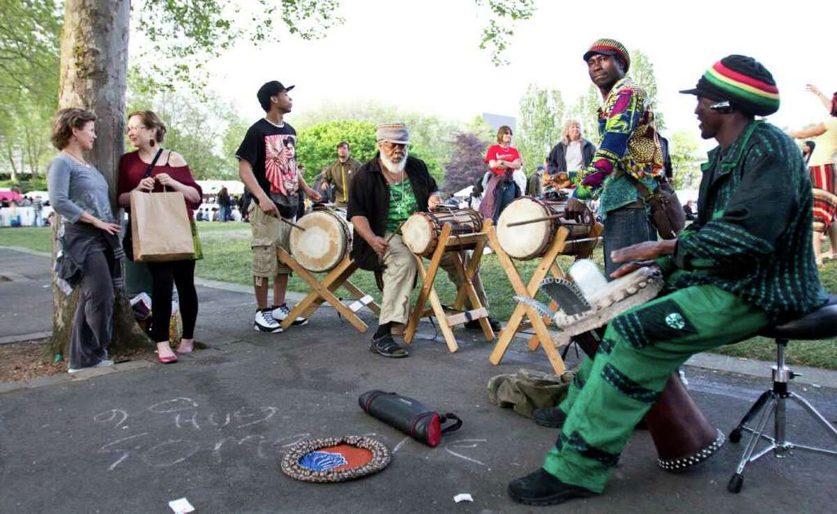 Dounia Djembe Drum and Dance performs at the Northwest Folklife Festival, on Monday.