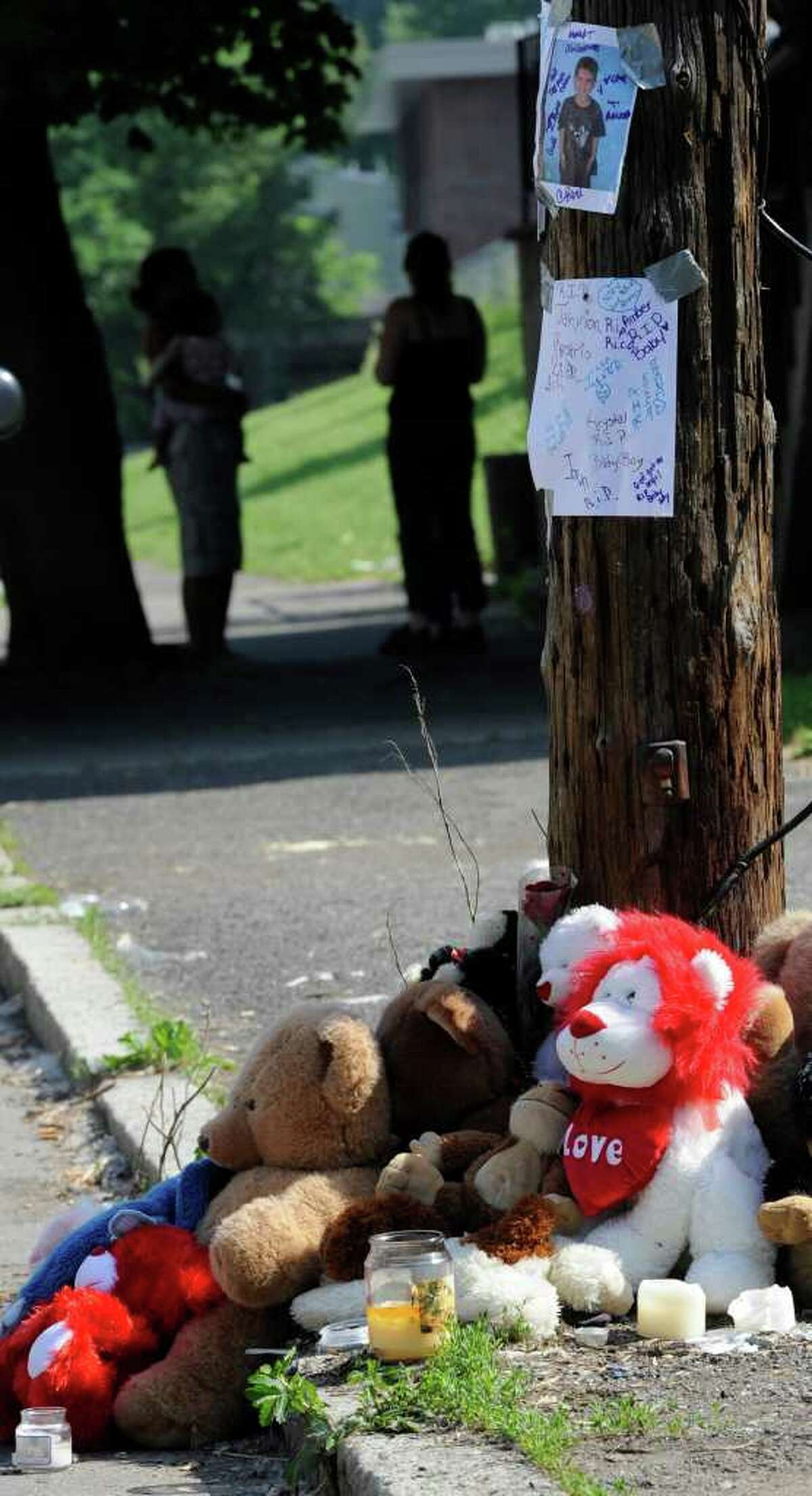 A memorial is set up on 10th Street just north of Rensselaer Street in Troy for Jahvion Perez, who was killed by Roy Sanders of Troy in a hit-and-run accident on Memorial Day. (Skip Dickstein / Times Union )