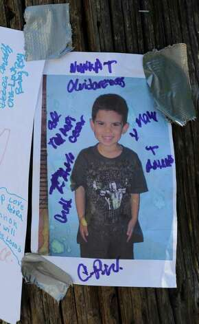 A photo of Jahvion Perez is taped to a utility pole at a memorial set up on 10th Street just north of Renssealer Street in Troy after the 6-year-old was killed by Roy Sanders in a hit-and-run accident on Memorial Day.  (Skip Dickstein / Times Union ) Photo: SKIP DICKSTEIN / 2008