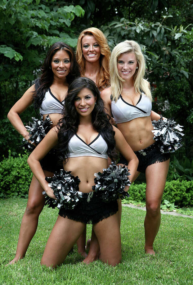 Spurs Silver Dancers Mandy Correa, 24; Heather Easley, 25; Melissa Stewart, 20; and Veronica Lind, 22, proudly represent the hometown Spurs in their silver and black uniforms. KEVIN GEIL / SPECIAL TO THE EXPRESS-NEWS