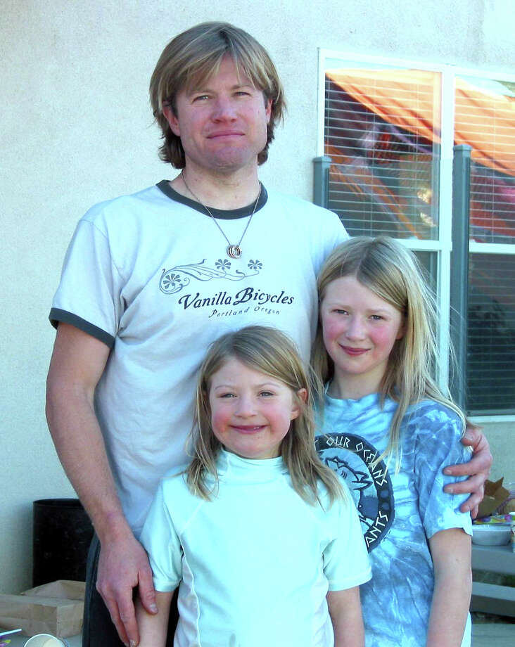 University of Washington researcher Kevin Black is pictured with his daughters Emily, left, and Megan. Black was killed in a February 2009 crash at a Ballard intersection.