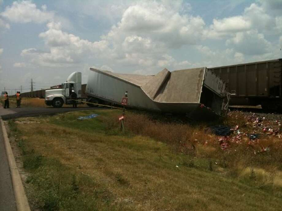 Traffic on the southbound frontage road of Interstate 35 near Walzem was  blocked by a wrecked truck that spilled a load of Dr. Pepper Photo: Jerry Lara/glara@express-news.net
