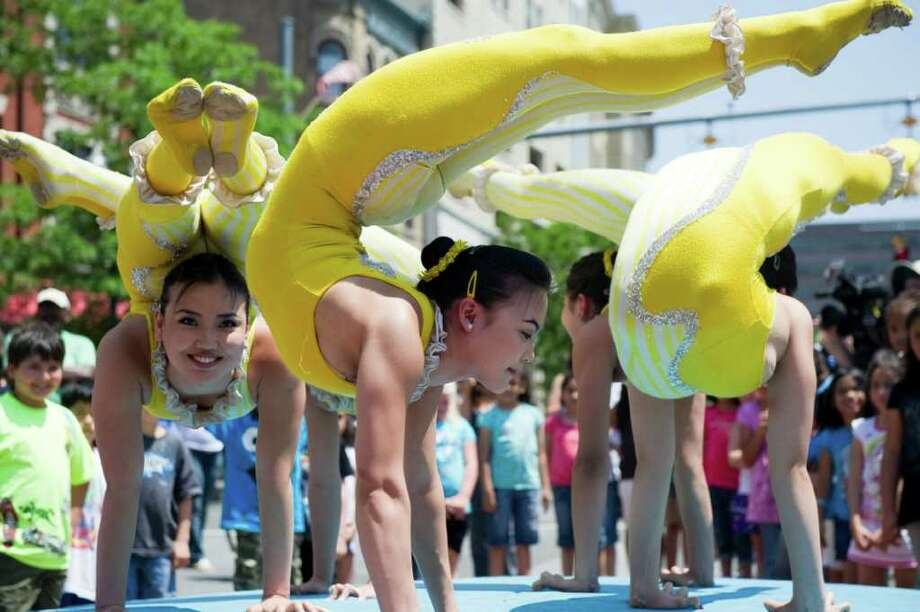 X Bud Roses Contortion Act from Mongolia offer a preview of the Big Apple Circus in Columbus Park, Stamford, Conn., May 31, 2011.  The Big Apple Circus returns to StamfordÕs Mill River Park from June 10 through July 4. Photo: Keelin Daly / Stamford Advocate