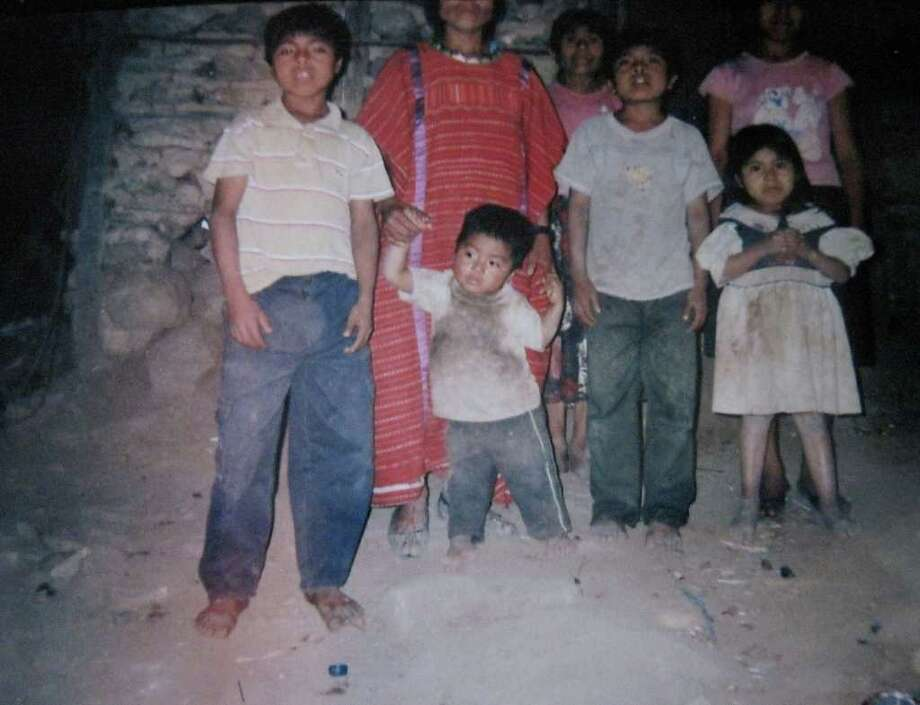 Agustina Cruz Garcia, the wife of the late 36-year-old Marcos DeJesus Alvarez, and her six children in their simple stone hut in their village of Santa Cruz Tilapa, population 100. (Family photo)