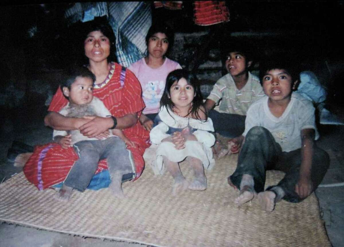 The wife and six children of Marcos DeJesus Alvarez, 36, who was shot and killed by a sheriff's deputy in Colonie near the airport on March 20, 2010. In their dirt-floored, stone hut in Santa Cruz Tilapa, a tiny village in the mountains of the central Mexican state of Oaxaca. After he could no longer support his family selling corn and coffee beans, Alvarez, an undocumented Mexican with fake papers, paid a coyote to smuggle him into the U.S. He was a member of an indigenous group, the Triqui, who speak an ancient tonal language different from Spanish and have been the targets of ethnic and political violence.(Family photo)