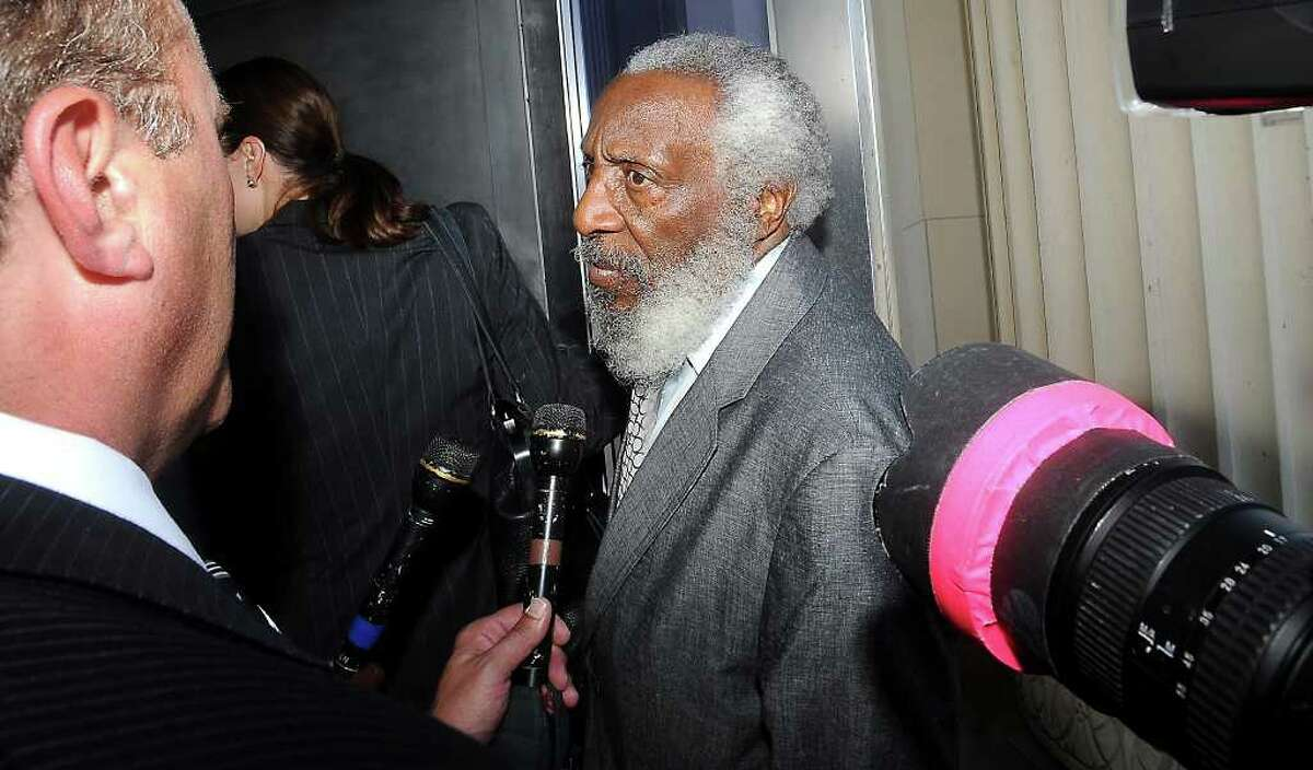 Comedian and activist, Dick Gregory talks to the press about Calvin Walker as he joins him in support at the Jack Brooks Federal Courthouse in Beaumont, Tuesday. Walker pleaded not guilty in his arraignment on the 37-count federal indictments that claim he overcharged BISD for electrical work. Tammy McKinley/The Enterprise