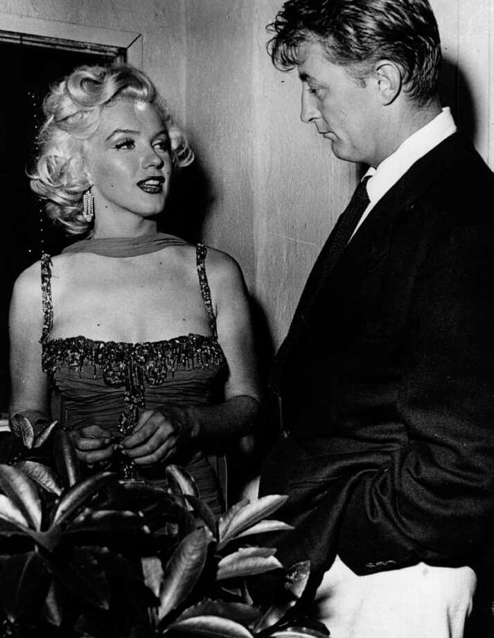 Monroe with actor Robert Mitchum at a Hollywood party in 1962. Photo: Keystone, Getty Images / Hulton Archive