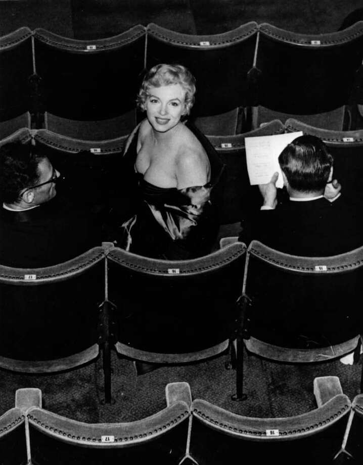 "Monroe and Miller (left) in the audience for a performance of Miller's play ""A View From The Bridge"" at the Comedy Theatre in London on October 12, 1956 Photo: Keystone, Getty Images / Hulton Archive"