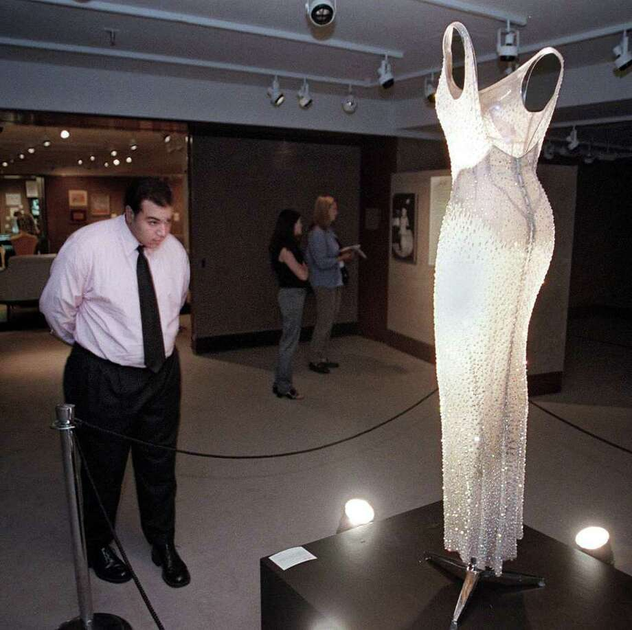 "As Elton John noted in the song ""Goodby Norma Jean,"" Monroe's legend has continued decades after her death. One of her most-iconic moments was singing ""Happy Birthday Mr. President"" to John F. Kennedy in May 1962 in Madison Square Garden, wearing the dress on display in this July 26, 1999 photo at Christie's in New York. The sheath dress, in flesh-colored souffle gauze encrusted with rhinestones, was so tight that Monroe had to be sewn into it. Photo: HENNY RAY ABRAMS, AFP/Getty Images / AFP"