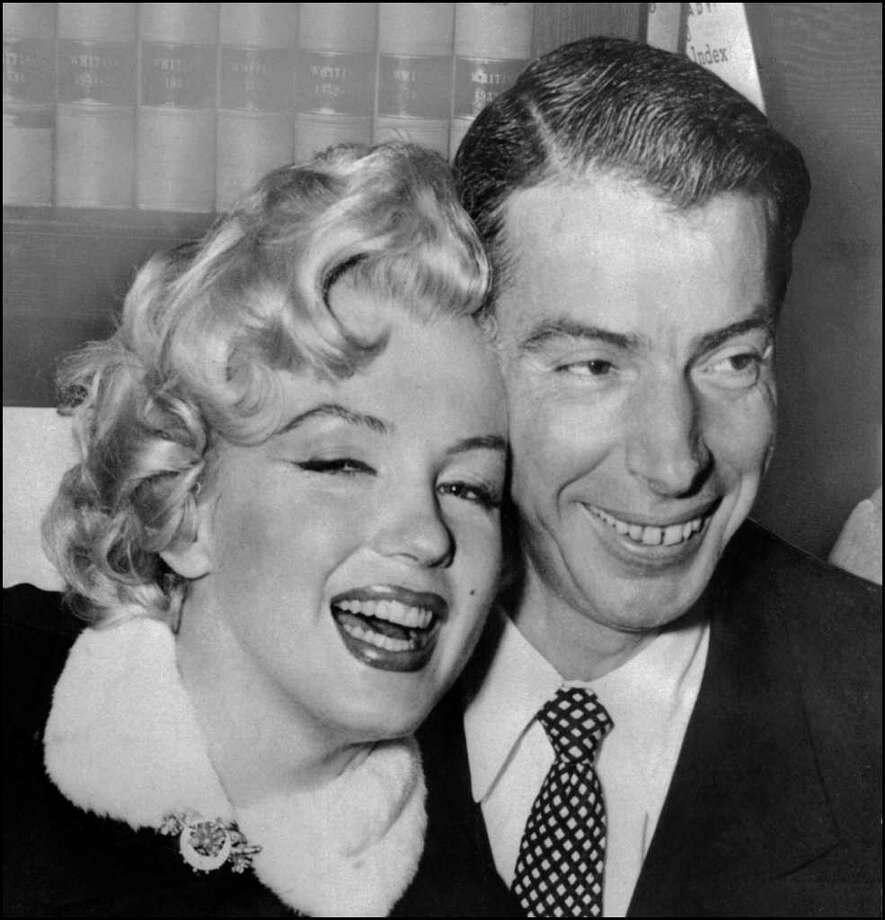Monroe with baseball legend Joe DiMaggio during their wedding ceremony April 1, 1954 at San Francisco City hall. Photo: AFP, AFP/Getty Images / AFP