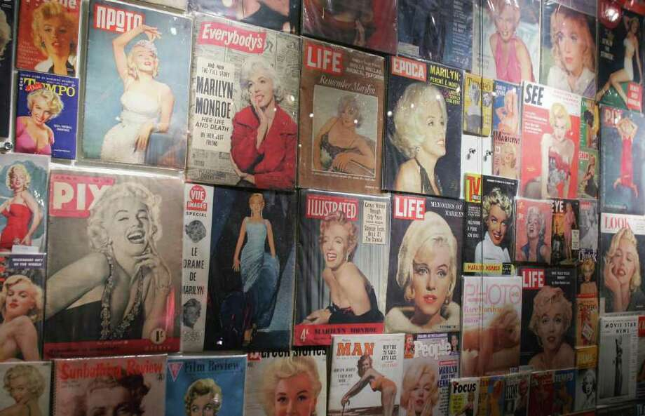 "Hundreds of magazines featuring Monroe on the cover are displayed at ""Marilyn Monroe: The Exhibit,"" on November 18, 2005 on the Queen Mary in Long Beach, California at the start of its world tour. Photo: ROBYN BECK, AFP/Getty Images / 2005 AFP"