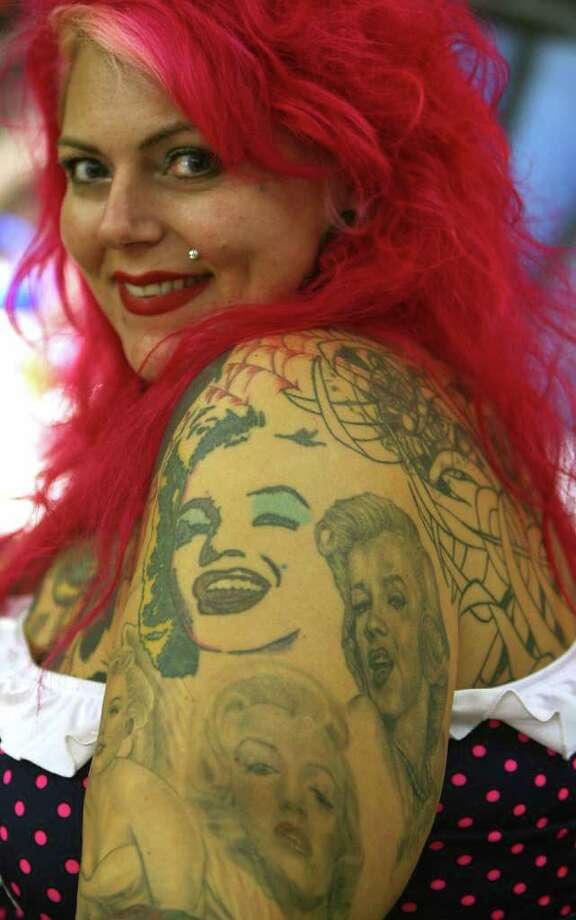 Tattoo artist Majenta, of Renton, Washington, displays her Monroe tattoos during the 15th Annual Inkslingers Ball, on September 15, 2006 in Los Angeles. Photo: GABRIEL BOUYS, AFP/Getty Images / 2006 AFP