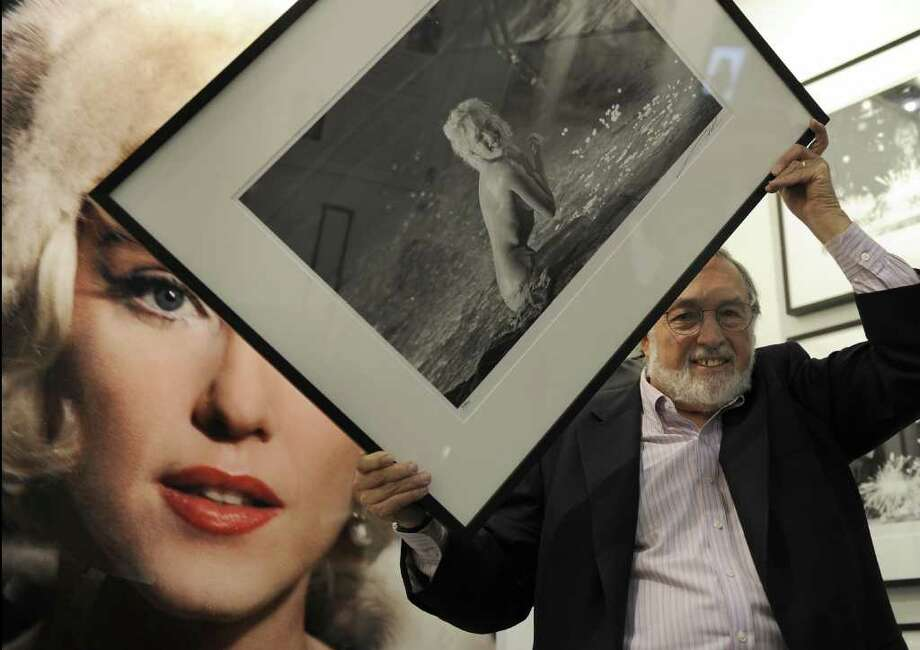 Former Life magazine photographer Lawrence Schiller holds a photo he shot of Monroe  during  the 2009 Art Expo at the Jacob Javits Convention Center in New York on February 26, 2009. This photo, done while  Monroe was frolicking naked in a swimming pool, was the last before her death. Photo: TIMOTHY A. CLARY, AFP/Getty Images / 2009 AFP