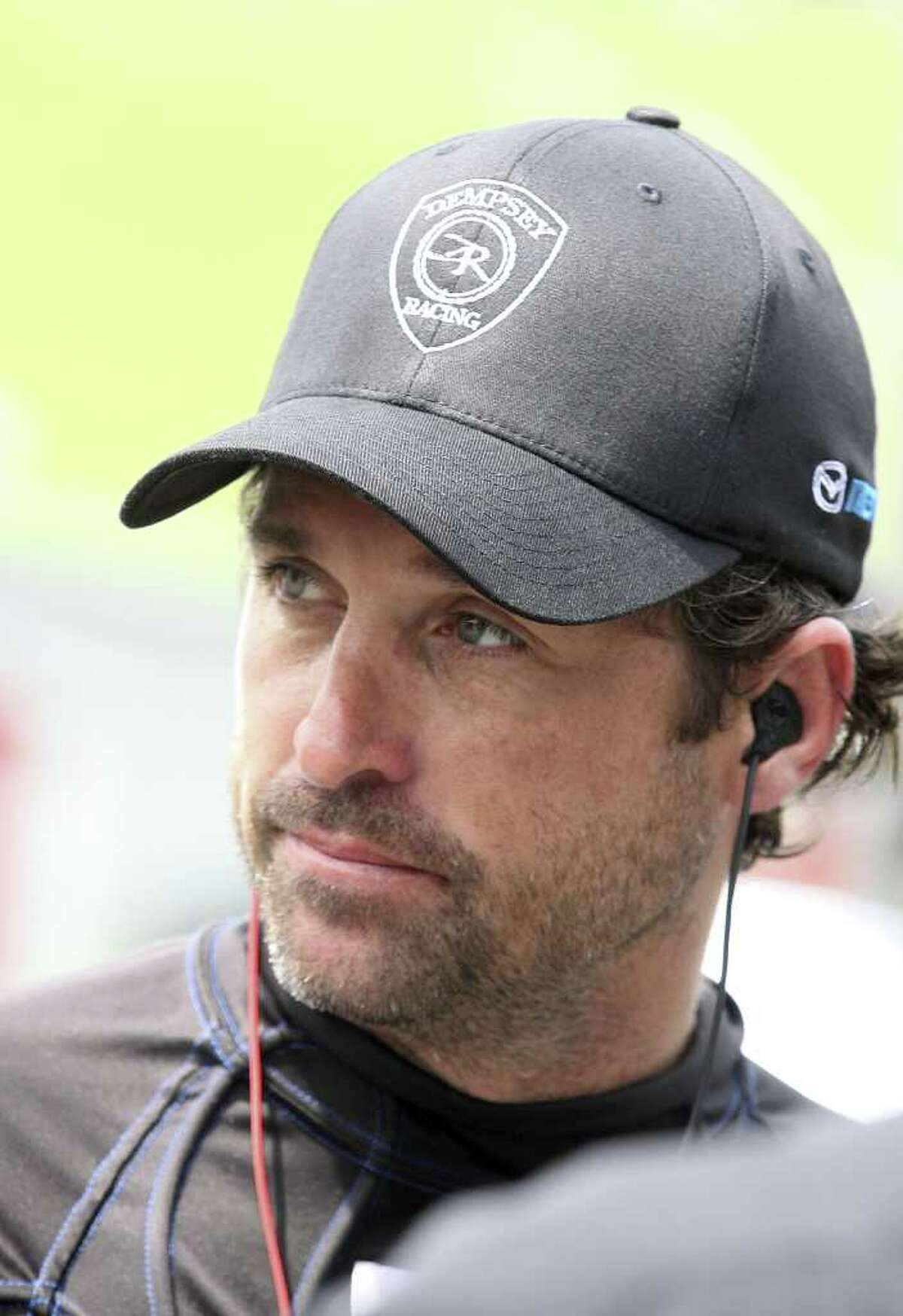 Driver/actor Patrick Dempsey stands in the pits before the Memorial Day Classic Grand-Am Rolex Series race at Lime Rock Park in Lakeville, Connecticut.