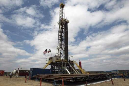 Drilling rigs like this one in near Tilden, Texas, are are becoming a common sight as companies are now drilling into the Eagle Ford shale formation using a process called hydraulic fracturing. Photo: JOHN DAVENPORT, SAN ANTONIO EXPRESS-NEWS / SAN ANTONIO EXPRESS-NEWS (Photo may be sold to the public)