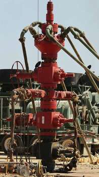 The well head at a fracking operation near Carrizo Springs has many valves and connections. The well for oil and gas is operated by Chesapeake Energy. Photo: SAN ANTONIO EXPRESS-NEWS