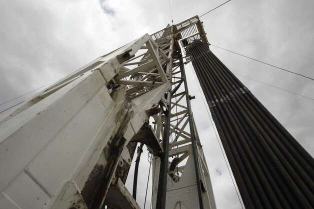 Drilling pipe is stacked on a rig near Tilden, Texas. Photo: JOHN DAVENPORT, SAN ANTONIO EXPRESS-NEWS / jdavenport@express-news.net