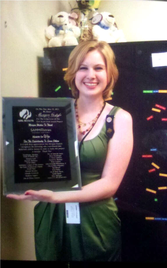 North Central San Antonio Girl Scout Morgan Gostylo completed her Gold Award community service project at the Haven for Hope downtown, helping to improve the reading room. She received a plaque from the Girl Scouts and SAMMinistries for her efforts. Photo: Courtesy Photos