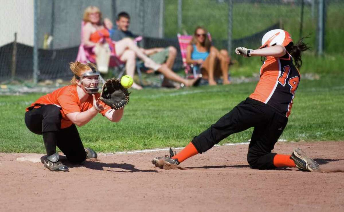 Stamford High School's Gretta Buckley slides safely into third as Shelton High School's Danielle Persson reaches for the throw during the softball CIAC Class LL game in Stamford, Conn. on Tuesday May 31, 2011. Stamford won 9-3.