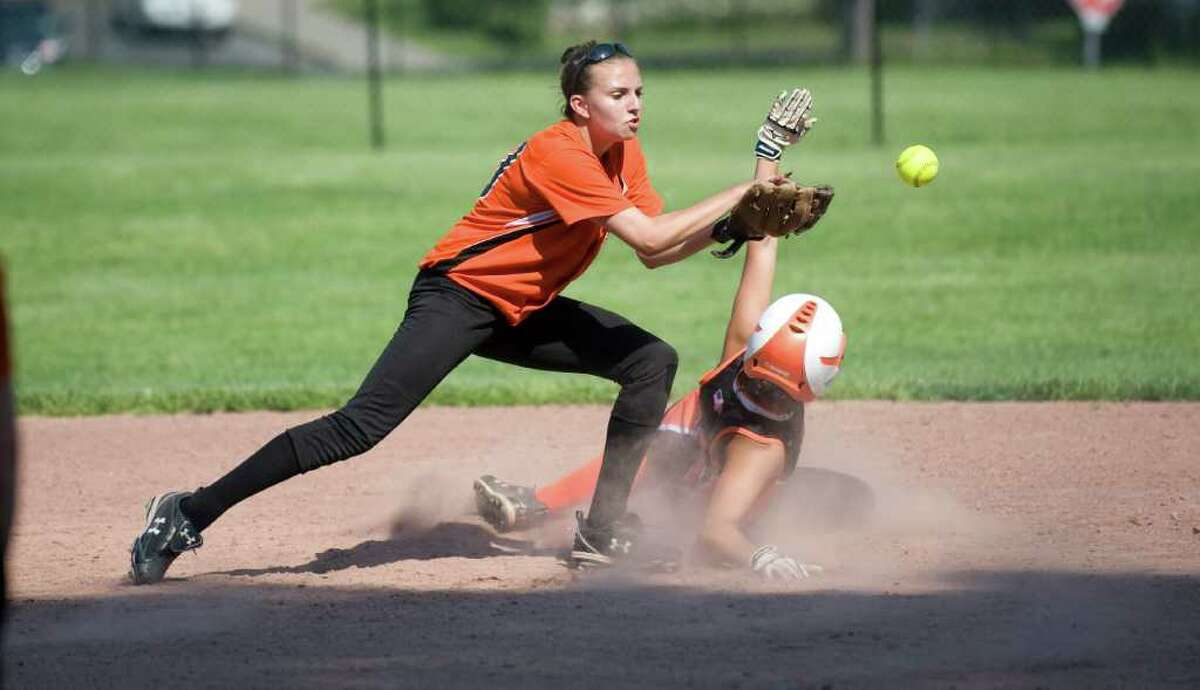 Stamford High School's Krista Robustelli slides safely into second as the throw gets past Shelton High School's Rachel Cataudella during the softball CIAC Class LL game in Stamford, Conn. on Tuesday May 31, 2011. Stamford won 9-3.