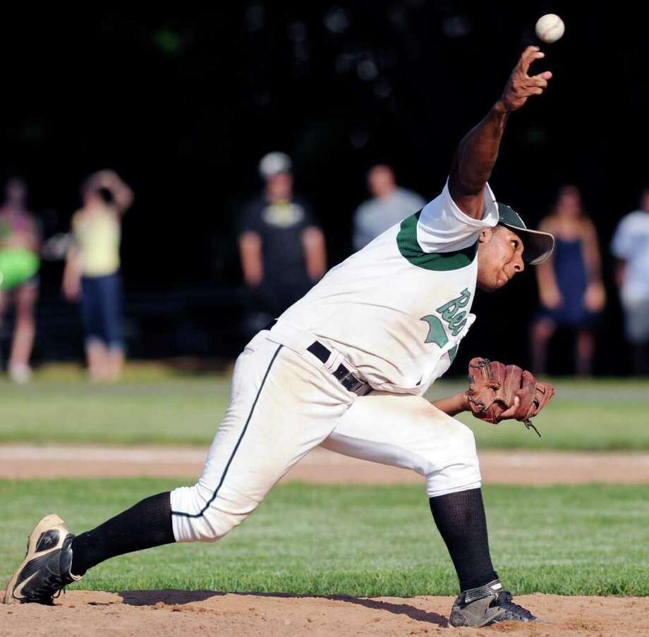 Napoleon Fleming of Norwalk High School throws relief duty during the Class LL boys high school baseball playoff game between Greenwich High School and Norwalk High School at City Hall Field, Norwalk, Tuesday afternoon, May 31, 2011. Photo: Bob Luckey, Greenwich Time / Greenwich Time