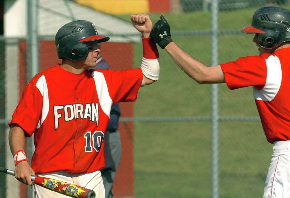 Highlights from CIAC boys Class L state baseball between Foran and Wethersfield in Milford, Conn. on Tuesday May 31, 2011. Foran's #10 Tucker Schumitz, left.