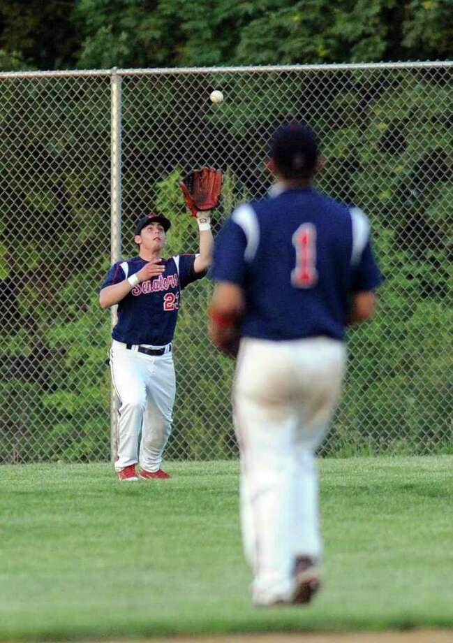 Scott Angeley makes a catch during Tuesday's game at Brien McMahon High School on May 31, 2011. Photo: Lindsay Niegelberg / Connecticut Post
