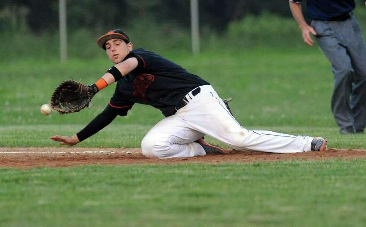Tom Fabricatore of Stamford misses the ball at first base during Tuesday's game at Brien McMahon High School on May 31, 2011.
