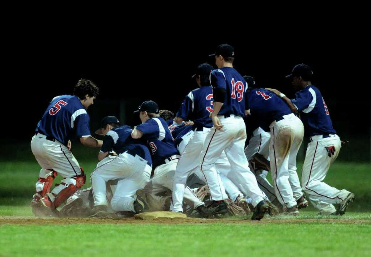 McMahon players celebrate winning Tuesday's game at Brien McMahon High School on May 31, 2011.