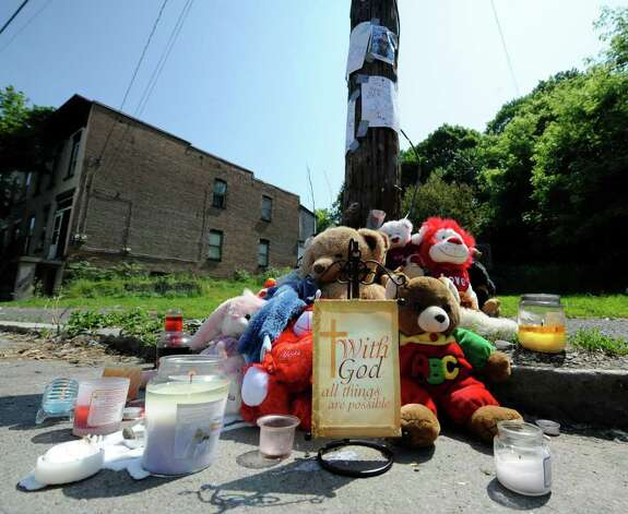 A memorial was set up on 10th Street just north of Renssealer Street in Troy after  Jahvion Perez, 6, was killed by Roy Sanders in a hit-and-run accident on Memorial Day. (Skip Dickstein / Times Union) Photo: SKIP DICKSTEIN / 2008