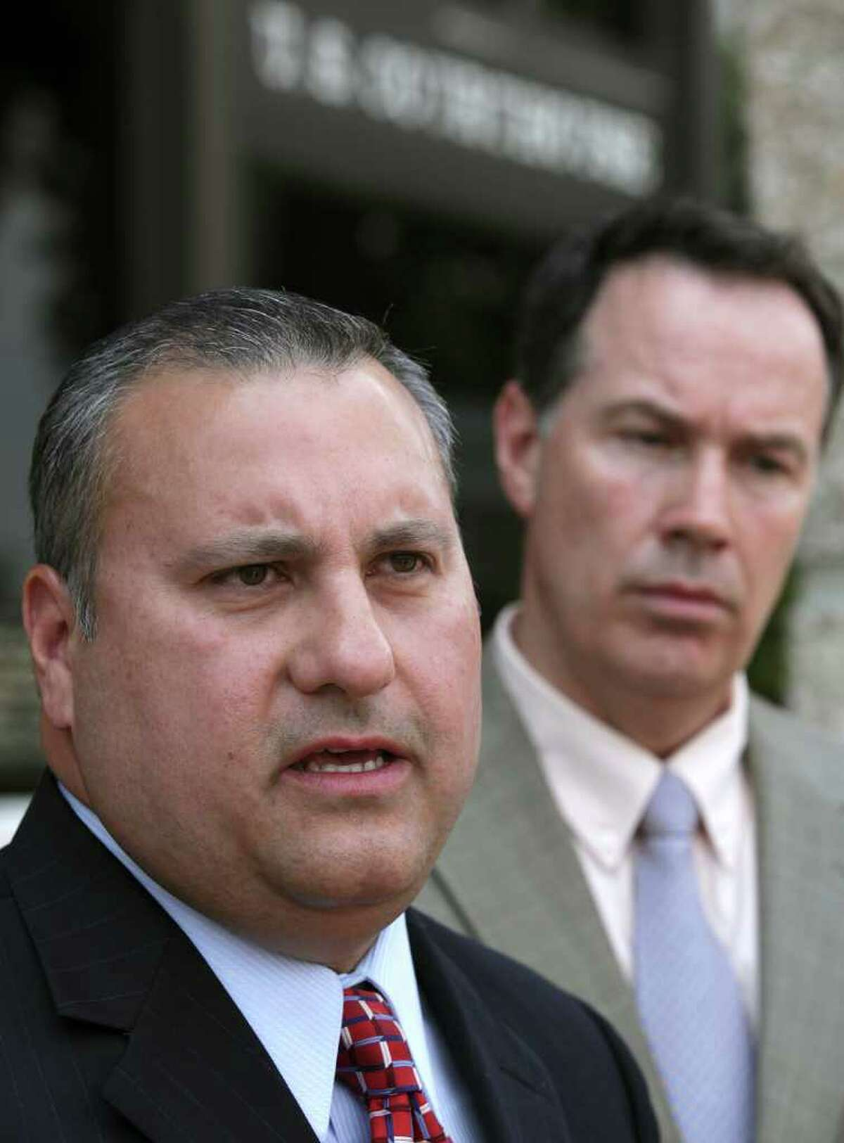 Chris Martinez, Assistant Superintendent Human Resources and Public Relations for Medina Valley ISD, speaks to the media following a hearing concerning the use of prayer in the Medina Valley High School's graduation ceremonies this Saturday. At right is the district's attorney, D. Craig Wood. Tuesday, May 31, 2011. Photo Bob Owen/rowen@express-news.net