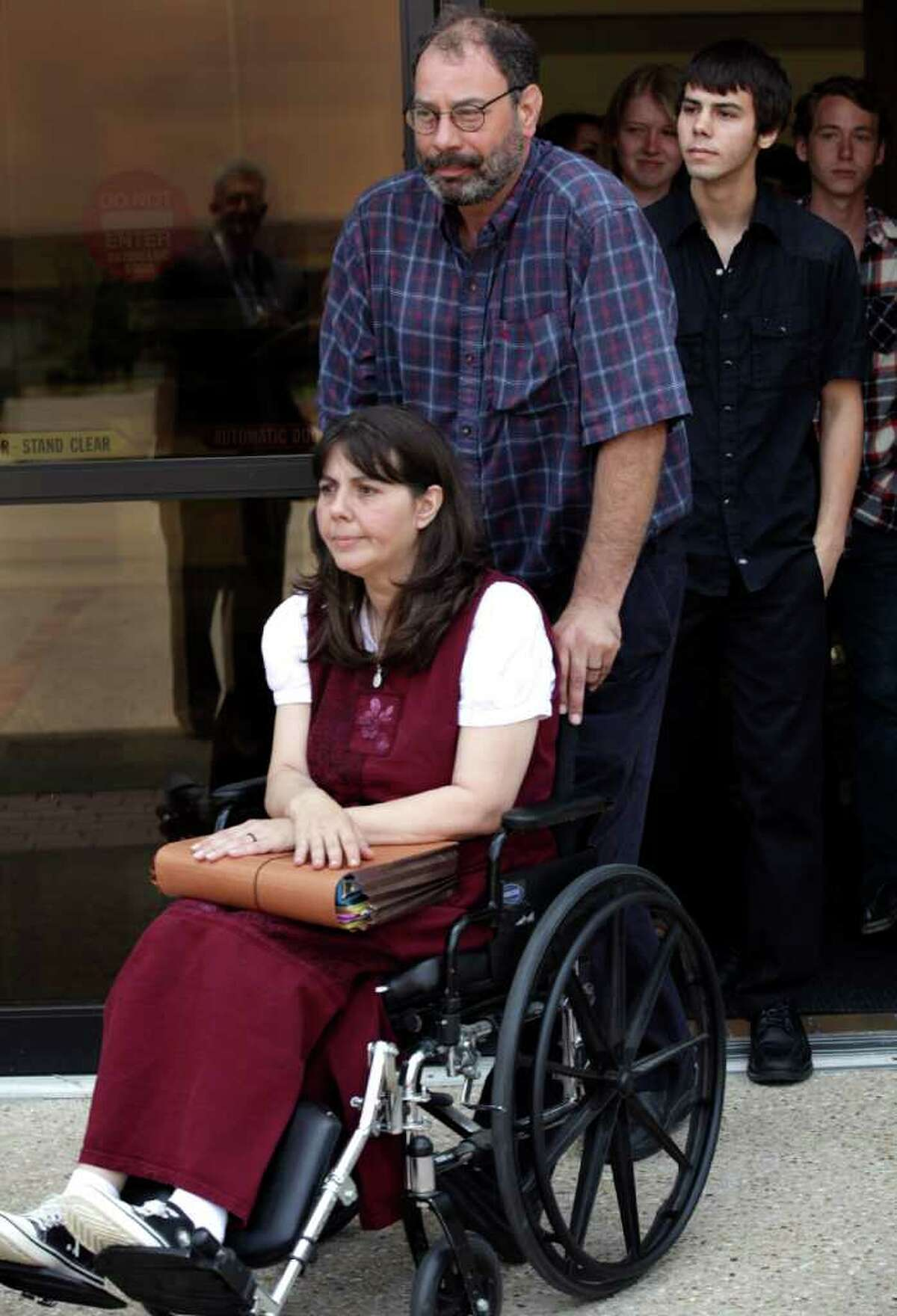 Danny Schultz escorts his wife Christa Schultz followed by their son Corwyn Schultz leave the U.S. Courthouse in San Antonio, May 31, after a hearing in which they are trying to ban the use of prayer during Medina Valley High School's graduation ceremonies this Saturday. Corwyn is in the graduating class.