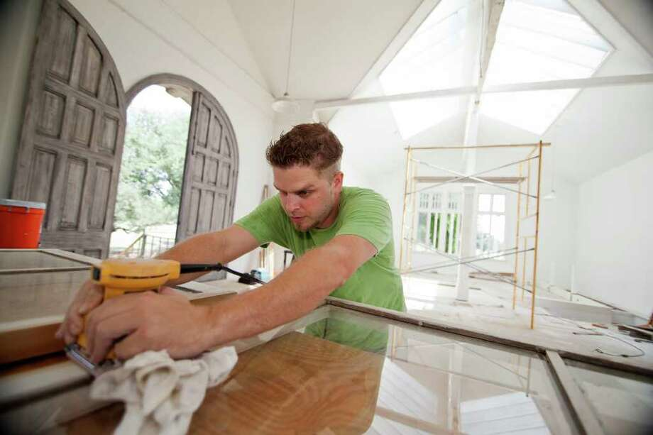 Quin Johnson of Randy Johnson Custom Designs sands a window frame last week at the historic Borglum Studio at Brackenridge Park Golf Course. The studio is being renovated as a major part of the future Texas Golf Hall of Fame and Museum. Photo: Andrew Buckley/Express-News / Copyright: Andrew Buckley