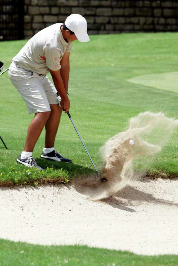 Christian De La Cruz, of San Antonio, hits from an awkward stance in a bunker on the 17th hole during the final round of last year's AJGA Valero Texas Open Junior Shootout at The Club at Sonterra. Photo: Bob Owen/Express-News