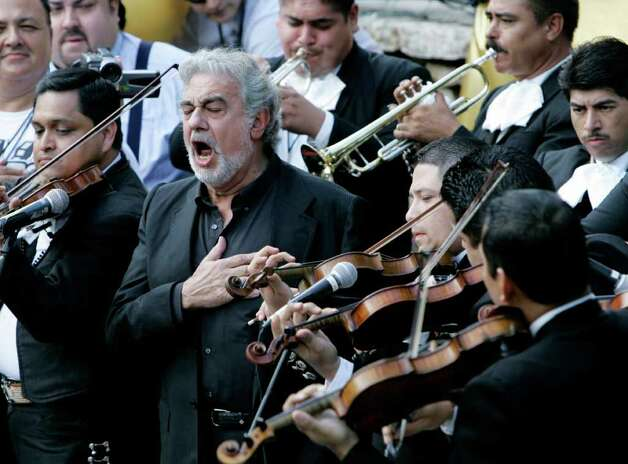 Placido Domingo, second from left, sings the national anthem during the San Antonio Spurs' river parade, celebrating winning the NBA Basketball Championship, in San Antonio, Sunday, June 17, 2007. Photo: Eric Gay, AP / AP