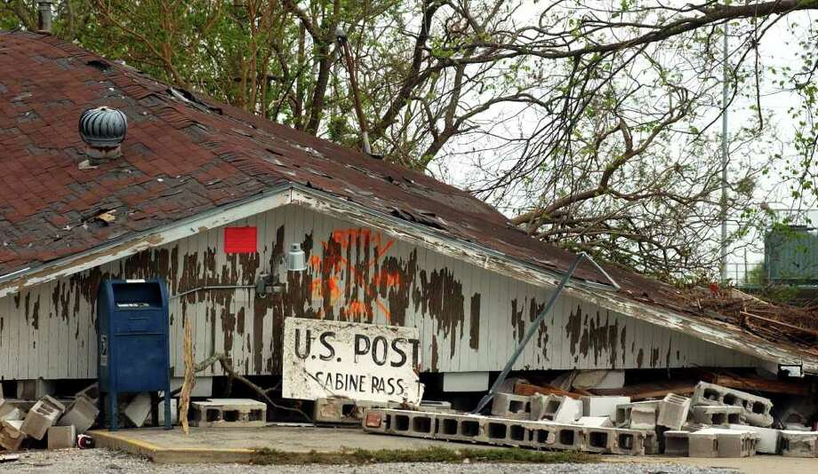 The Sabine Pass Post Office remains destroyed in Sabine Pass on Saturday, October 8, 2005. Hurricane Rita came ashore with category three winds and a storm surge near the pass on September 24, 2005. (AP Photo/The Beaumont Enterprise, Mark M. Hancock) Photo: Mark M. Hancock, Staff Photographer / © 2005 The Beaumont Enterprise