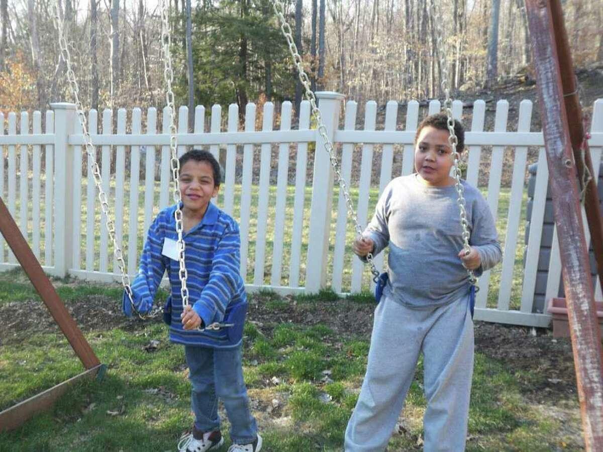 Lucca Fabrizio-Garcia, 7, left, and Nicolaz Fabrizio-Garcia, 9 in their New Fairfield backyard.