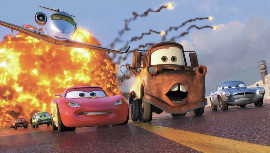 "In this film publicity image released by Disney, characters Lightning McQueen, voiced by Owen Wilson, left, Mater, voiced by Larry the Cable Guy, and Finn McMissile, voiced by Michael Caine, right, are shown in a scene from ""Cars 2. Photo: AP Photo/Disney/Pixar / ©Disney/Pixar.  All Rights Reserved."