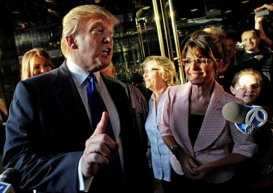 Donald Trump makes a point as he walks with former governor of Alaska Sarah Palin in New York City as they make their way to a scheduled meeting Tuesday, May 31, 2010. Photo: Craig Ruttle, AP / FR61802 AP