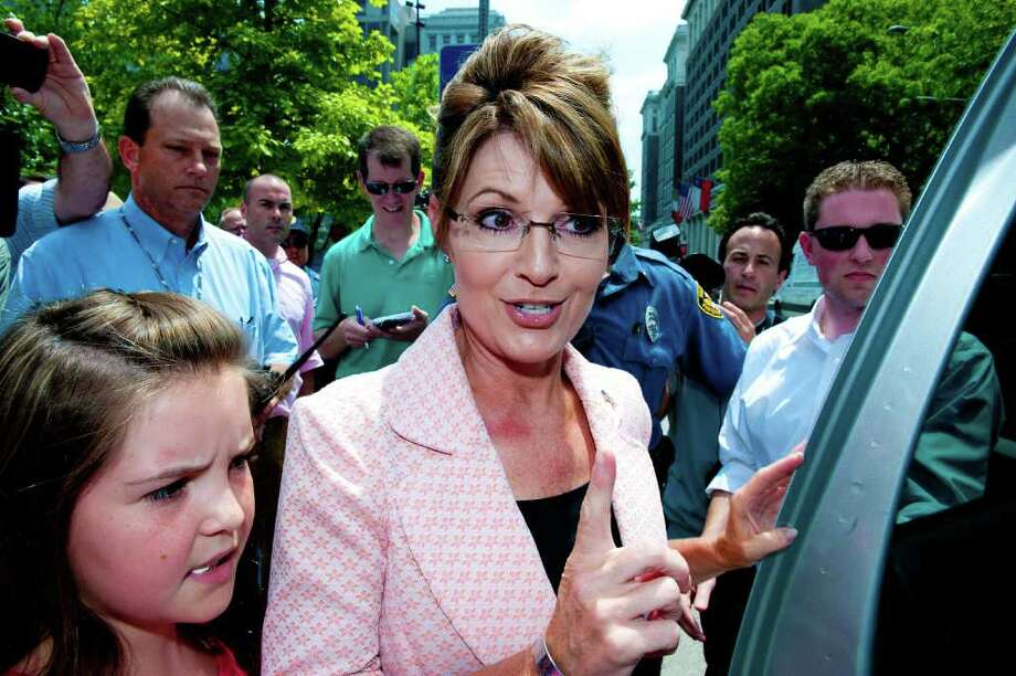 "PHILADELPHIA, PA - MAY 31: Sarah Palin (C) speaks with the press outside the Liberty Bell Center as part of her ""One Nation"" bus tour as her daughter Piper (L) looks on May 31, 2011 in Philadelphia, Pennsylvania. Palin is visiting American landmarks during the tour, although she is not informing the media as to where she is going, promting many media outlets to follow her bus from place to place.  (Photo by Jeff Fusco/Getty Images)  *** BESTPIX *** Photo: Jeff Fusco, Getty Images / 2011 Getty Images"