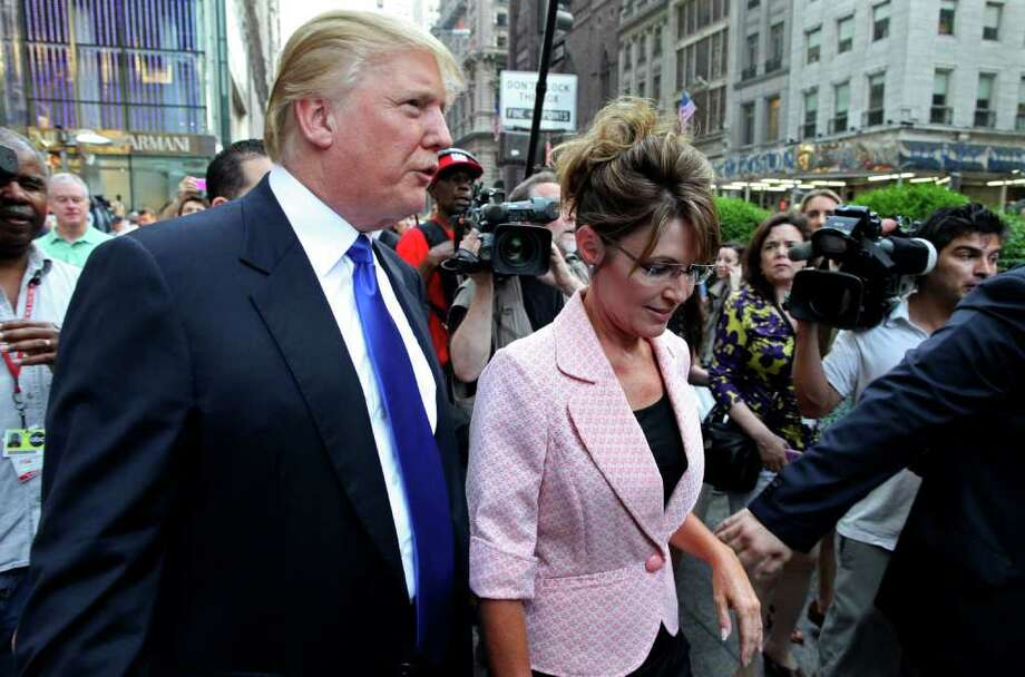 **CORRECTS YEAR** Former governor of Alaska Sarah Palin walks with Donald Trump in New York City  as they make their way to a scheduled meeting Tuesday, May 31, 2011. Photo: Craig Ruttle, AP / FR61802 AP