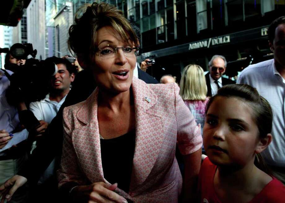 Former governor of Alaska Sarah Palin walks to the door of Trump Tower for a scheduled meeting with Donald Trump in New York, Tuesday, May 31, 2011. Photo: Craig Ruttle, AP / FR61802 AP