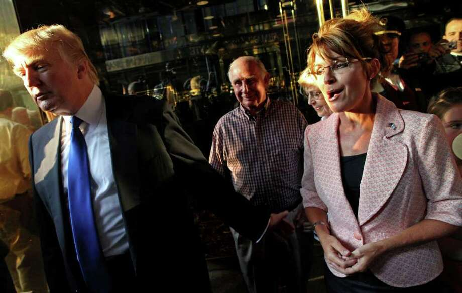 Donald Trump walks with former governor of Alaska Sarah Palin in New York City as they make their way to a scheduled meeting Tuesday, May 31, 2010. Photo: Craig Ruttle, AP / FR61802 AP