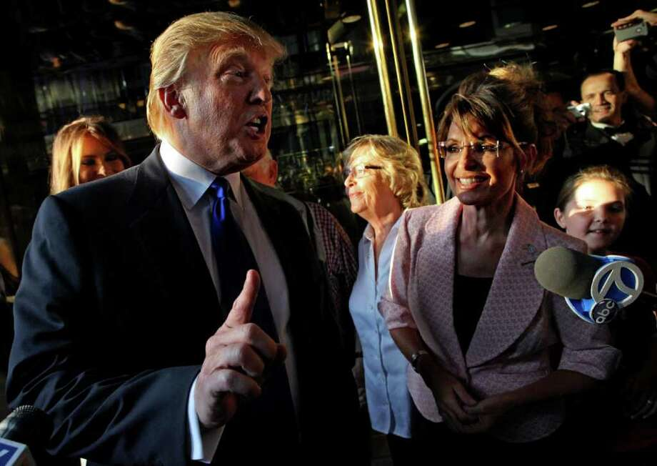 **CORRECTS YEAR** Donald Trump makes a point as he walks with former governor of Alaska Sarah Palin in New York City as they make their way to a scheduled meeting Tuesday, May 31, 2011. Photo: Craig Ruttle, AP / FR61802 AP