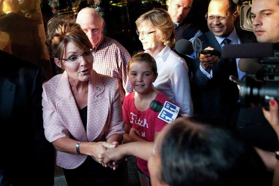 NEW YORK, NY - MAY 31:  Former U.S. Vice presidential candidate and Alaska Governor Sarah Palin (L), shakes hands with a supporter after leaving Trump Tower with Donald Trump (not seen), at 56th Street and 5th Avenue, on May 31, 2011 in New York City.  Palin and Trump met for a dinner meeting in the city. Photo: Andrew Burton, Getty Images / 2011 Getty Images