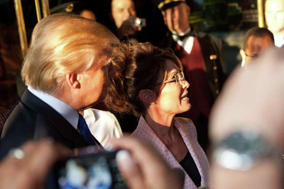 NEW YORK, NY - MAY 31:  Former U.S. Vice presidential candidate and Alaska Governor Sarah Palin (R), and Donald Trump (L), answer questions from the media after leaving Trump Tower, at 56th Street and 5th Avenue, on May 31, 2011 in New York City.  Palin and Trump met for a dinner meeting in the city. Photo: Andrew Burton, Getty Images / 2011 Getty Images