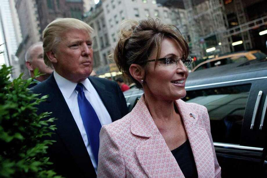 NEW YORK, NY - MAY 31:  Former U.S. Vice presidential candidate and Alaska Governor Sarah Palin (R), and Donald Trump walk towards a limo after leaving Trump Tower, at 56th Street and 5th Avenue, on May 31, 2011 in New York City.  Palin and Trump met for a dinner meeting in the city. Photo: Andrew Burton, Getty Images / 2011 Getty Images