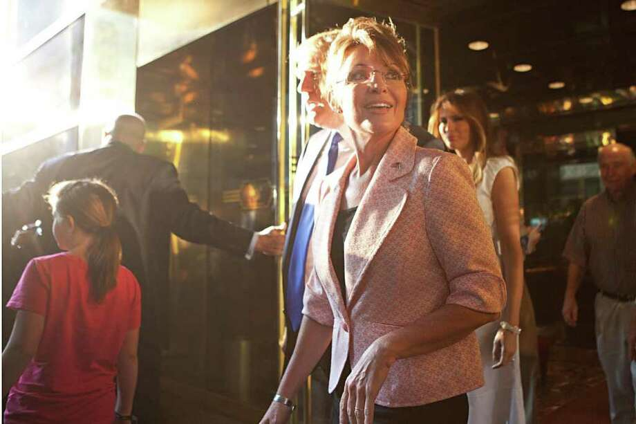 NEW YORK, NY - MAY 31: Former U.S. Vice presidential candidate and Alaska Governor Sarah Palin, forground, and Donald Trump exit Trump Tower, at 56th Street and 5th Avenue, on May 31, 2011 in New York City.  Palin and Trump met for a dinner meeting in the city. Photo: Andrew Burton, Getty Images / 2011 Getty Images